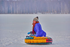 Happy Young Woman Sleigh Ride. Happy Young Woman on a fast Sleigh Ride down the icy slope Stock Images