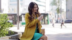 Happy young woman with smartphone and headphones stock video footage