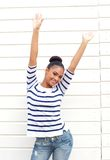 Happy young woman smiling with arms raised Royalty Free Stock Images