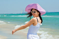 Happy young woman smiling on the beach royalty free stock image