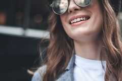 Cheerful young lady in trendy shades stock photography