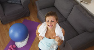 Happy young woman smiling after exercising Stock Image