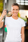 Happy young woman smiling at fitness gym center Royalty Free Stock Photos