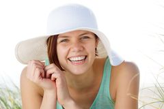 Happy young woman smiling with hat Stock Photography