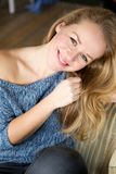Happy young woman smiling at home Royalty Free Stock Photography