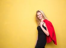 Happy young woman smiling with jacket Royalty Free Stock Images