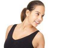 Happy young woman smiling and looking away Royalty Free Stock Photography