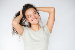 Happy young woman smiling and looking at one side. Smile happy woman young curls Stock Photo