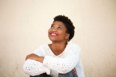 Happy young woman smiling and looking up Royalty Free Stock Photo