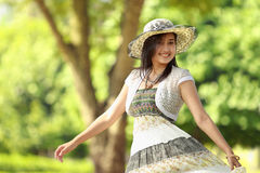 Happy young woman smiling in a park Stock Photos