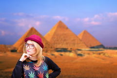 Happy young woman smiling on pyramid background Royalty Free Stock Photo