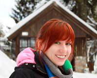 Happy Young Woman Smiling, Spending Her Winter Holiday In A Mountain Cabin Stock Photos