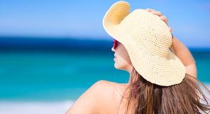 Happy young woman smiling in straw hat with closed Royalty Free Stock Photography