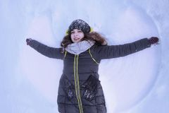 Happy young woman on snow as symbol of Christmas angel New Yea