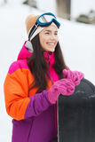 Happy young woman with snowboard outdoors Royalty Free Stock Photo