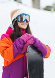 Happy young woman with snowboard outdoors Stock Photography