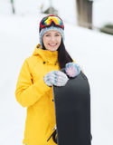 Happy young woman with snowboard outdoors Royalty Free Stock Photos