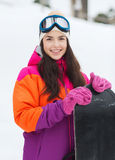 Happy young woman with snowboard outdoors Stock Images