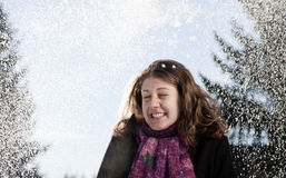Happy young woman in snowfall Royalty Free Stock Image