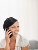 Happy young woman speaking mobile phone Royalty Free Stock Images