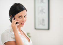 Happy young woman speaking mobile phone Stock Photo
