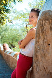 Happy young woman spending time in Park Guell, Spain Royalty Free Stock Photography