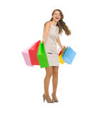 Happy young woman spinning  shopping bags Royalty Free Stock Image