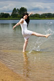 Happy young woman splashing water Stock Photo