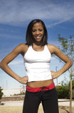 Happy young woman in sports wear Royalty Free Stock Images