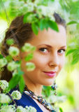 Happy young woman among a spring blossom Royalty Free Stock Image