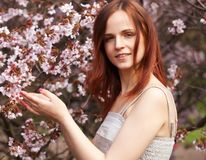 Happy young woman in spring flowers garden Royalty Free Stock Photo