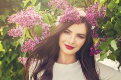 Happy young woman with spring flowers outdoors royalty free stock images