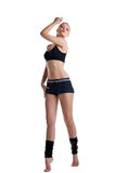 Happy young woman stand in fitness dress Stock Image