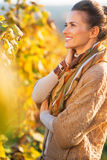 Happy young woman standing in autumn vineyard Royalty Free Stock Images