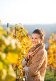 Happy young woman standing in autumn vineyard Royalty Free Stock Photo