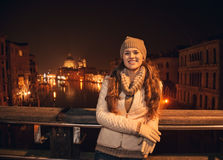 Happy young woman standing on a bridge overlooking Grand canal Royalty Free Stock Image