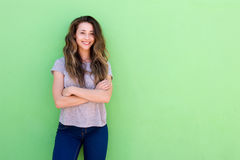 Happy young woman standing with folded arms. Portrait of happy young woman standing with folded arms stock photo