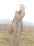 Happy, young woman standing in green field Royalty Free Stock Photography