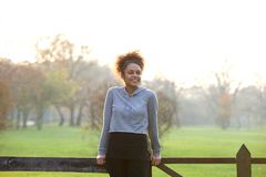 Happy young woman standing outdoors in nature Stock Photos
