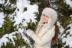 Happy young woman standing outdoors near snowy spruce branch Stock Photography