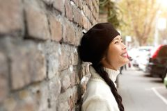 Happy young woman standing outside with beret Royalty Free Stock Images