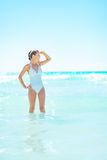 Happy young woman standing in sea Stock Images