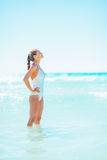 Happy young woman standing in sea and relaxing Royalty Free Stock Photos