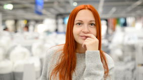 Happy young woman is standing in a shopping mall stock footage