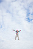 Happy young woman standing on the snow hill Royalty Free Stock Images