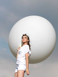Happy young woman standing with white balloon Stock Photos