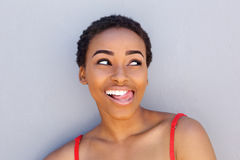 Happy young woman sticking tongue out Royalty Free Stock Photo