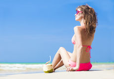 Happy young woman in straw hat and bikini with Royalty Free Stock Image