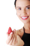 Happy young woman with strawberry. Royalty Free Stock Images
