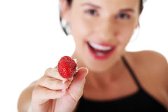 Happy young woman with strawberry. Stock Images